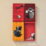 Come-un-pupazzo---installazione---spray-e-acrilico-su-cassette-da-frutta---50x35-circa-l'una